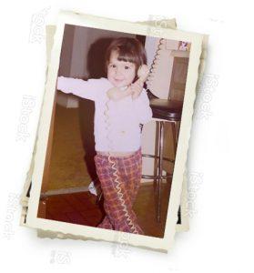 Jennifer Lee on the telephone as a little girl